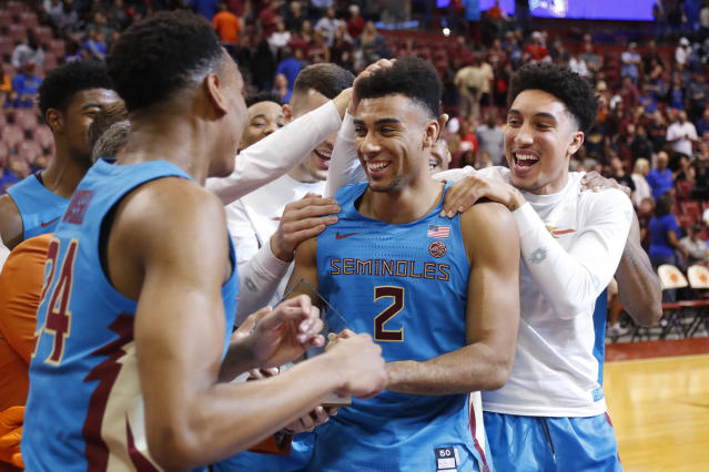 Florida State guard Anthony Polite (2) is mobbed by teammates after he received the MVP trophy after an NCAA college basketball game against South Florida, part of the Orange Bowl Classic tournament, Saturday, Dec. 21, 2019, in Sunrise, Fla. Florida State defeated South Florida 66-60. (AP Photo/Wilfredo Lee)