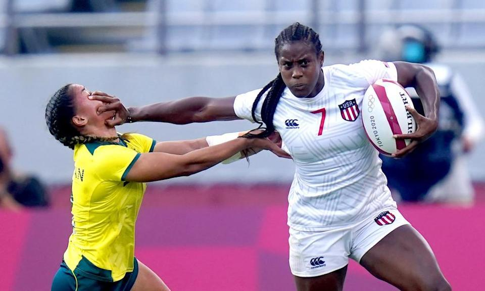 Naya Tapper (right) brushes off Australia's Faith Nathan during the rugby sevens fifth-place play-off.