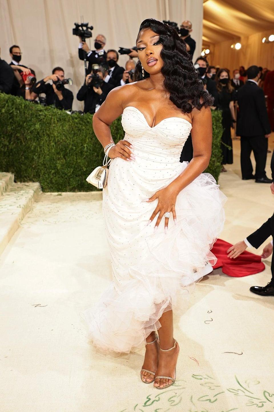 The rapper wore a white gown by Coach. (Getty)