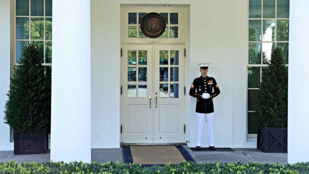 PHOTO: A Marine is posted at the West Wing door, an indication that President Donald Trump is in the Oval Office, at the White House in Washington, Oct. 7, 2020. (Jonathan Ernst/Reuters)