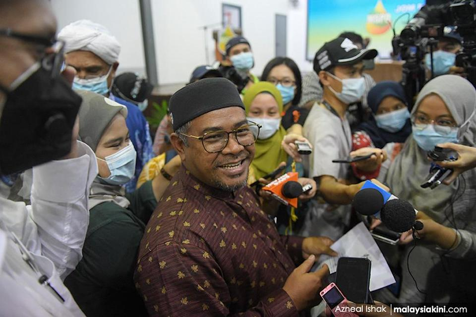 PAS' Plantation Industries and Commodities Minister Khairuddin Aman Razali became a focal point for unhappiness over double standards when he was given a light punishment after quarantine irregularities following a trip to Turkey. Here, he is surrounded by reporters on Aug 28, 2020.