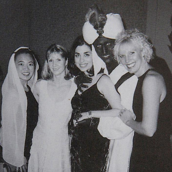"""Justin Trudeau poses with others at an """"Arabian Nights"""" party when he was a 29-year-old teacher at the West Point Grey Academy in Vancouver - Reuters"""