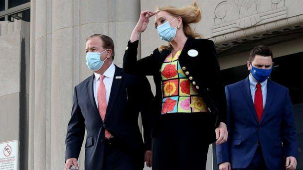 PHOTO: Patricia and Mark McCloskey leave the Carnahan Courthouse in St. Louis, Mo., trailing their lawyer Joel Schwartz, left, on Oct. 14, 2020. (St. Louis Post-Dispatch/TNS via Getty Images, FILE)