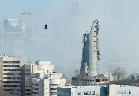 A bird flies near the unfinished and abandoned TV tower shortly after a controlled demolition in Yekaterinburg, Russia March 24, 2018. REUTERS/Alexei Kolchin