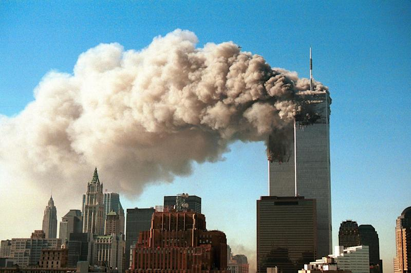 Attack: The twin towers of the World Trade Center after they were hit by two hijacked airliners: Getty Images