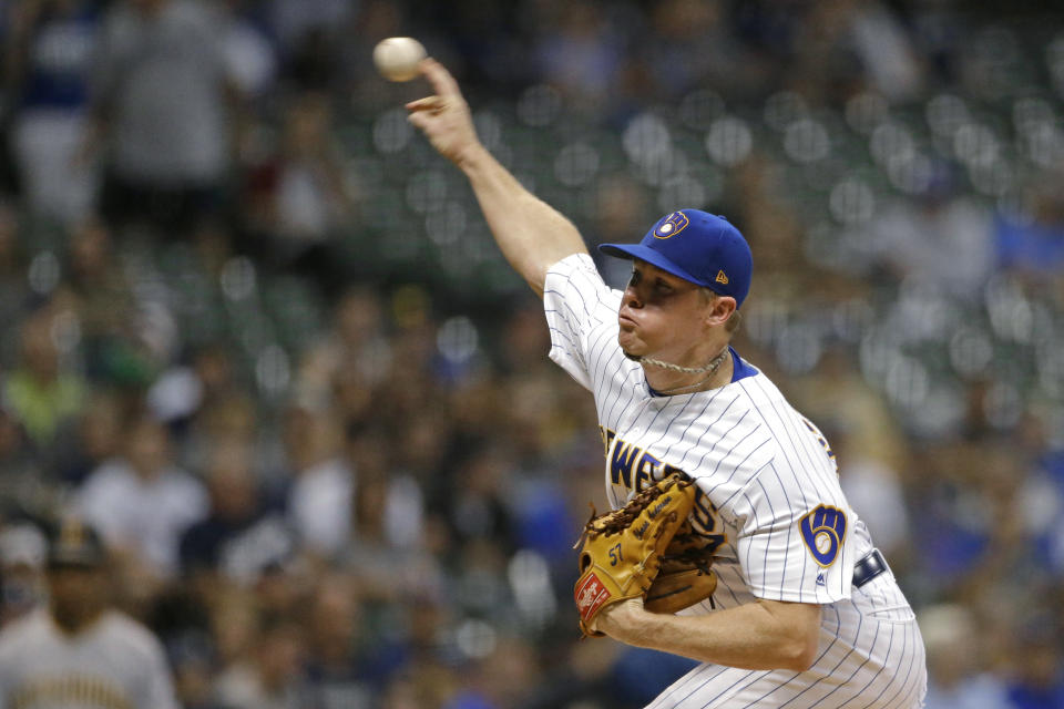 Milwaukee Brewers' Chase Anderson pitches during the first inning of the team's baseball game against the Pittsburgh Pirates on Friday, Sept. 20, 2019, in Milwaukee. (AP Photo/Aaron Gash)