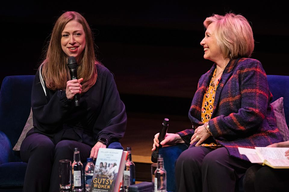 Chelsea Clinton (left) and Hillary Clinton at the Southbank Centre in London at the launch of Gutsy Women: Favourite Stories of Courage and Resilience a book by Chelsea Clinton and Hillary Clinton about women who have inspired them. (Photo by Aaron Chown/PA Images via Getty Images)