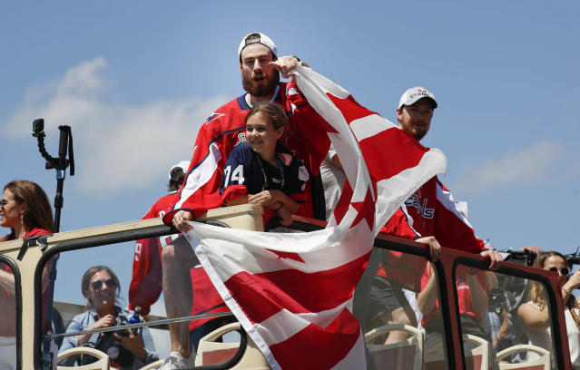 Washington Capitals goaltender Philipp Grubauer (31), of Germany, points to fans during the Stanley Cup NHL hockey victory parade in Washington, Tuesday, June 12, 2018. (AP Photo/Pablo Martinez Monsivais)