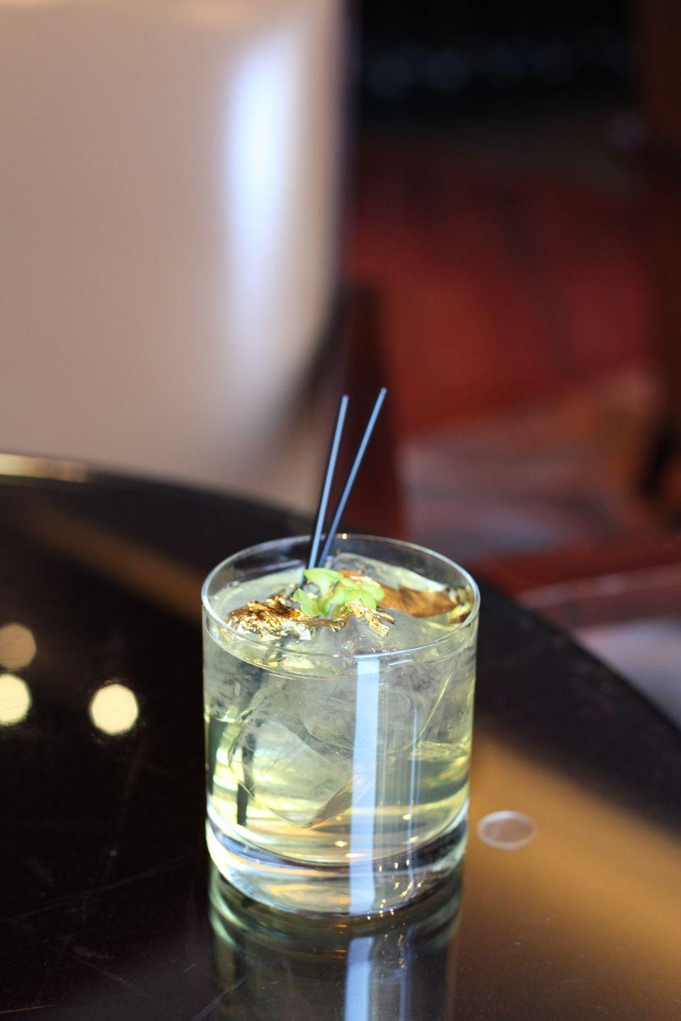 """<p><strong>Ingredients</strong></p><p>.75 oz Chartreuse<br>.75 oz Grand Marnier<br>Splash of Fever Tree Tonic Water<br>Edible gold flakes and microgreens</p><p><strong><strong>Instructions</strong></strong></p><p>Combine ingredients and mixing glass with ice and stir. Top with splash of tonic water and garnish with gold flakes and microgreens.</p><p><em>From The Four Seasons Denver in Denver, CO.</em></p><p><strong>More:</strong> <a href=""""https://www.townandcountrymag.com/leisure/drinks/g1165/best-st-patricks-day-cocktails/"""" rel=""""nofollow noopener"""" target=""""_blank"""" data-ylk=""""slk:The Best Cocktails to Sip on St. Patrick's Day"""" class=""""link rapid-noclick-resp"""">The Best Cocktails to Sip on St. Patrick's Day</a><br></p>"""