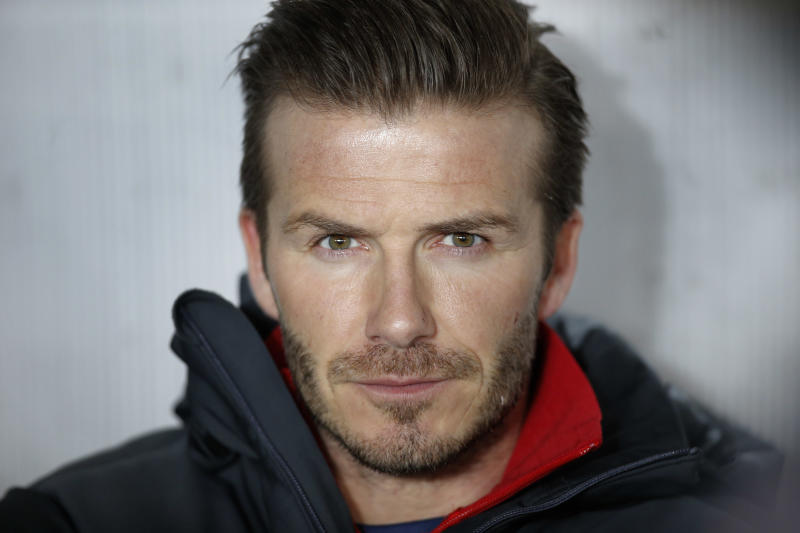 Paris Saint Germain's David Beckham sits on the bench during their League One soccer match between PSG and Montpellier at Parc des Princes Stadium, in Paris, Friday March 29, 2013. (AP Photo/Francois Mori)