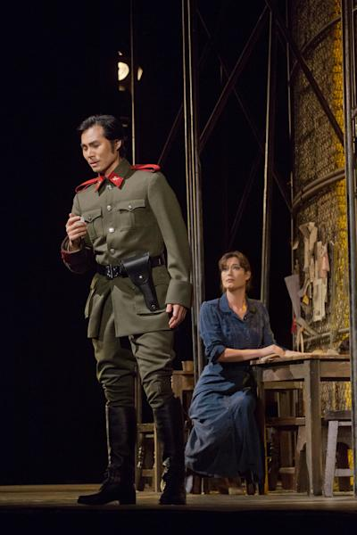 """In this Sept. 22, 2012 photo provided by the Metropolitan Opera, Yonghoon Lee performs in the role of Don Jose opposite Kate Royal as Micaela in Bizet's """"Carmen,"""" during a rehearsal at the Metropolitan Opera in New York. (AP Photo/Metropolitan Opera, Ken Howard)"""