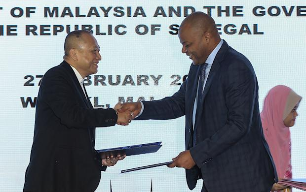 Datuk Seri Nazri Aziz (left) with Senegal Minister Mame Mbaye Niang during the signing of the memorandum of understanding at Matic, Kuala Lumpur February 27, 2018. — Picture by Azneal Ishak