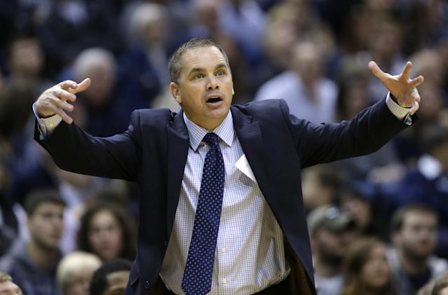 Butler interim head coach Chris Holtmann gestures to his players as they played Indiana in the first half of an NCAA college basketball game in Indianapolis, Saturday, Dec. 20, 2014. (AP Photo/Michael Conroy)