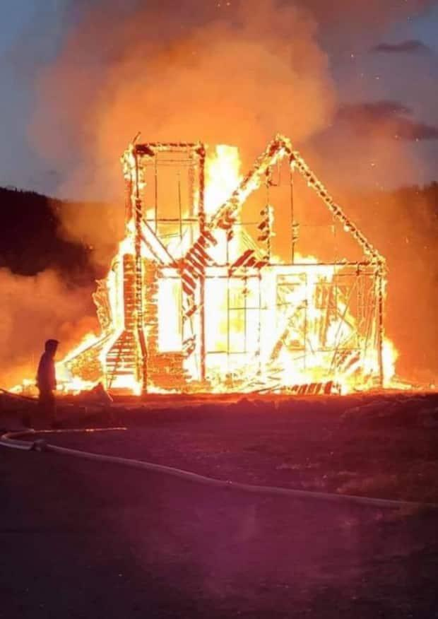 A fire late on July 1 destroyed an Anglican church near New Hazelton in northern B.C. (Submitted by Chasity Daniels - image credit)
