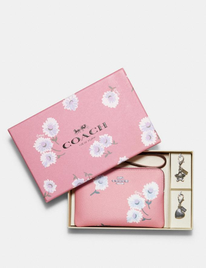 Boxed Corner Zip Wristlet With Daisy Print. Image via Coach Outlet.
