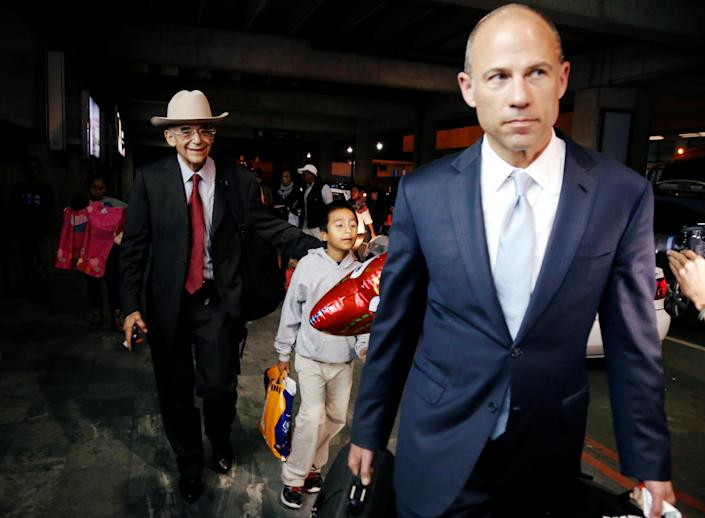 """<span class=""""s1"""">Michael Avenatti, right, with 8-year-old Anthony David Tobar and attorney Ricardo de Anda in Guatemala City, where the boy was reunited with his mother. (Photo: Luis Echeverria/Reuters)</span>"""