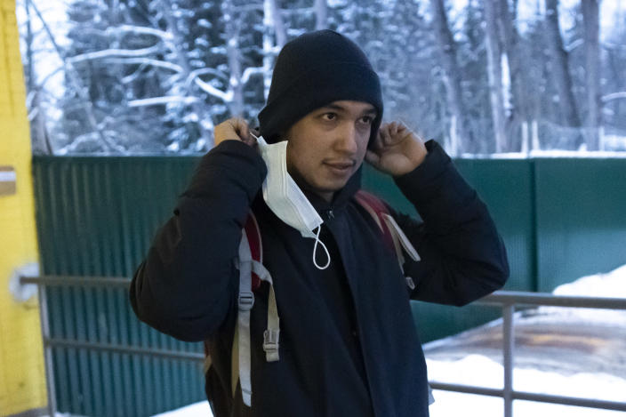 Almir Shamasov, a 30 year-old architect, walks out of the deportation centre Sakharovo, 70km (43,7 miles) south-west of Moscow which was urgently transformed into a detention center in the absence of prison space where he spent 10 days for talking part in a demonstration against the jailing of Russian Opposition leader Alexei Nalvalny, outside Moscow, Russia, Wednesday, Feb. 3, 2021. Shamasov said he spent 20 hours in a police van suffering from the effects of engine fumes or shivering from the cold when it was cut off. (AP Photo/Pavel Golovkin)
