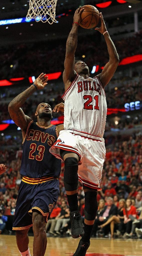 Jimmy Butler of the Chicago Bulls goes up for a shot past LeBron James of the Cleveland Cavaliers in Game Four of the Eastern Conference Semifinals at United Center on May 10, 2015 (AFP Photo/Jonathan Daniel)