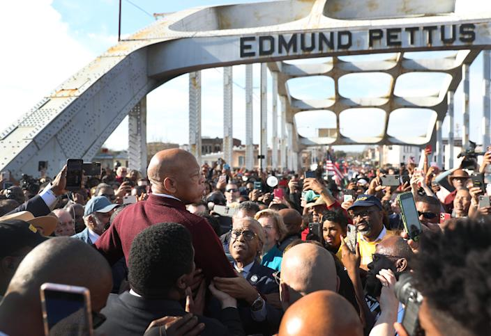 Rep. John Lewis speaks to the crowd at the Edmund Pettus Bridge crossing reenactment marking 55th anniversary of Selma's Bloody Sunday on March 1, 2020, in Selma, Alabama. Lewis marched for civil rights across the bridge 55 years ago.