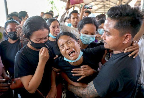 PHOTO: Thida Hnin cries during the funeral of her husband Thet Naing Win at Kyarnikan cemetery in Mandalay, Myanmar, Feb. 23, 2021. Thet Naing Win was shot and killed by Myanmar security forces during an anti-coup protest on Feb. 20. (AP)