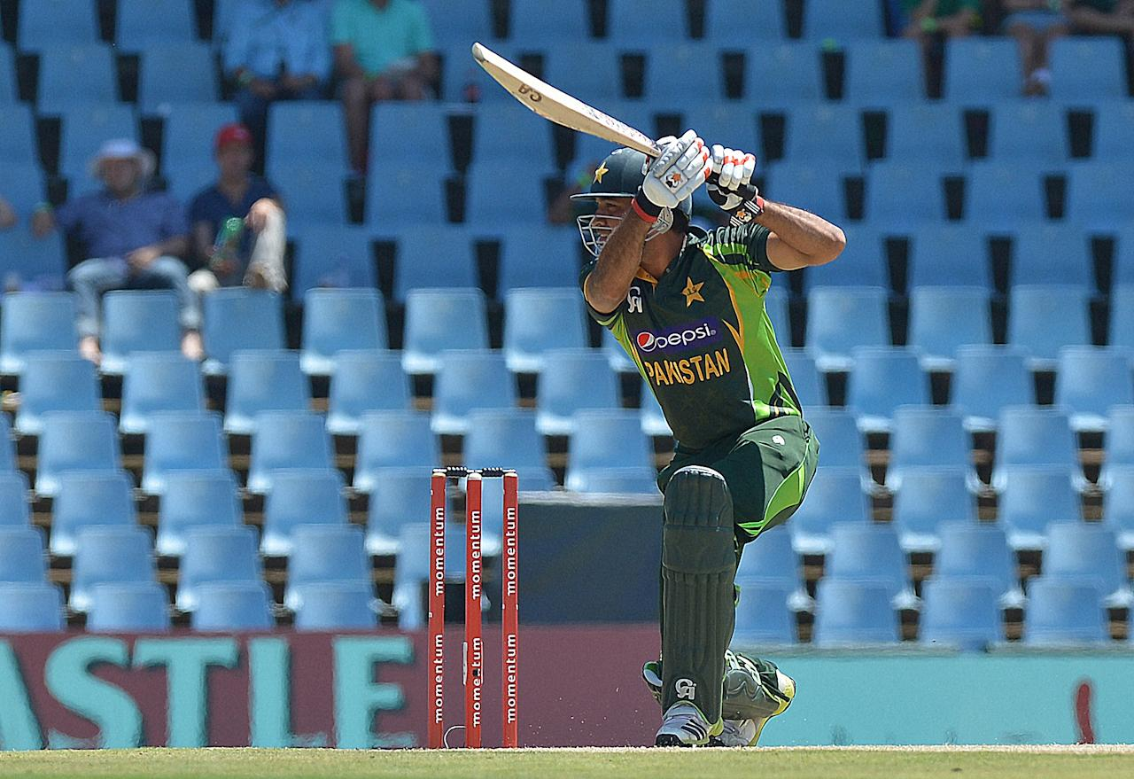 Pakistan's cricketer Anwar Ali plays a shot from unseen South Africa's cricketer Lonwabo Tsotsobe during the final ODI between South Africa and Pakistan at SuperSport Park in Centurion on November 30, 2013.  AFP PHOTO / ALEXANDER JOE