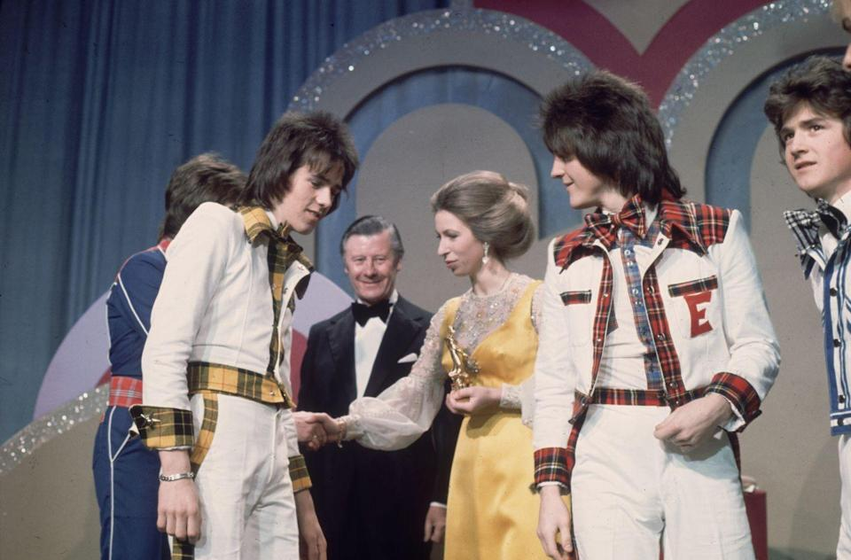 <p>The Bay City Rollers, a Scottish pop band, seem taken with the Princess as she greets them onstage at the Carl Alan Awards.<br></p>