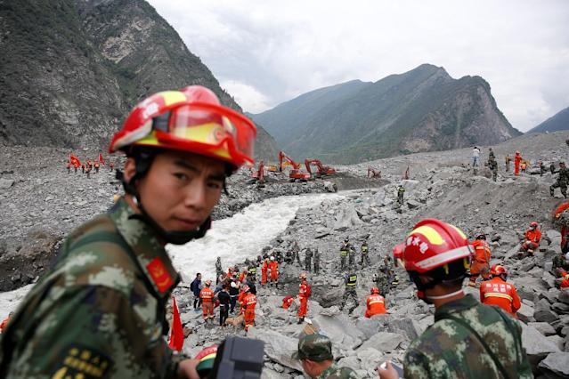 <p>Rescue workers search for survivors at the site of a landslide in the village of Xinmo, Mao County, Sichuan Province, China June 26, 2017. (Photo: Aly Song/Reuters) </p>