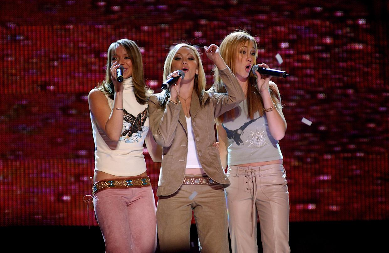 Atomic Kitten performing on stage during the Smash Hits T4 Poll Winners Party at the London Arena in Docklands.From the left, Liz McClarnon, Jenny Frost and Natasha Hamilton.   (Photo by Yui Mok - PA Images/PA Images via Getty Images)