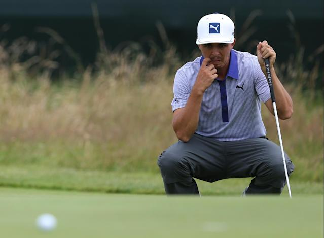 Rickie Fowler of the US lines up a putt on the 17th green during the third day of the British Open Golf championship at the Royal Liverpool golf club, Hoylake, England, Saturday July 19, 2014. (AP Photo/Scott Heppell)
