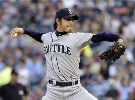 Seattle Mariners pitcher Hisashi Iwakuma throws to the Minnesota Twins in the first inning of a baseball game, Friday, May 31, 2013 in Minneapolis. (AP Photo/Jim Mone)