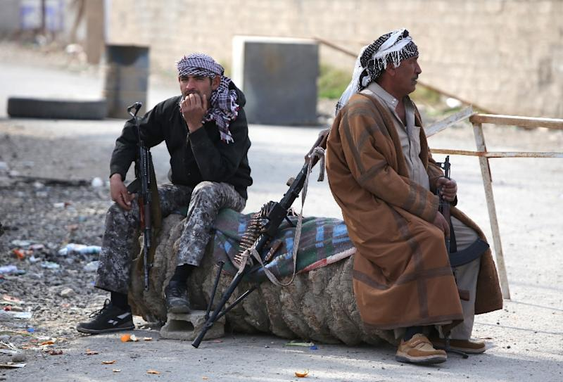 Iraqi Sunni fighters from the Jubur tribe rest after defeating Islamic State group fighters in the village of Sharween in Diyala province, on January 27, 2015 (AFP Photo/Ahmad al-Rubaye)