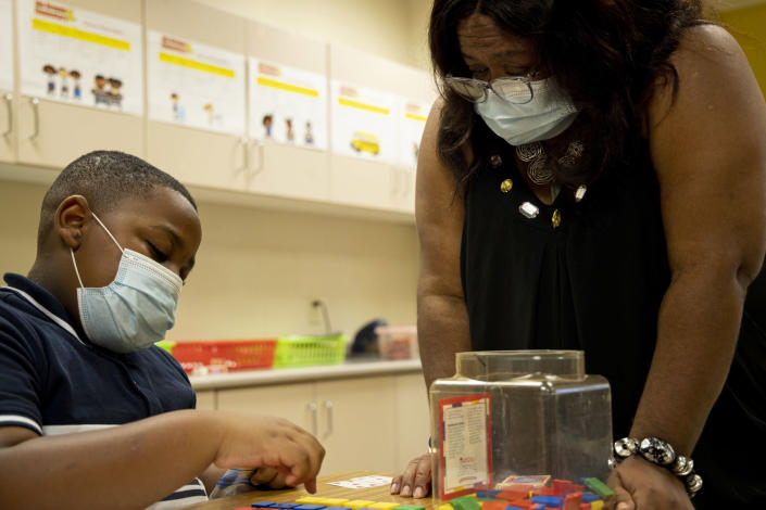 Donylen Bullock works on multiplication with his teacher, Nechia Coleman, during summer school at Ida Green Elementary in Belzoni, Miss., on June 30, 2021. (Brad Vest / for NBC News)