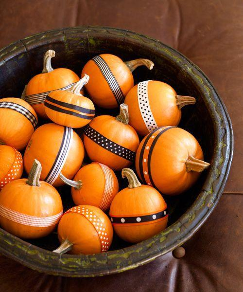 """<p>For a no-fuss fall centerpiece, heap mini pumpkins in a shallow bowl. Attach double-stick tape to lengths of black, orange, and white patterned ribbon, then wrap around each squash.</p><p><a class=""""link rapid-noclick-resp"""" href=""""https://www.amazon.com/dp/B07GN36SDQ/?tag=syn-yahoo-20&ascsubtag=%5Bartid%7C10055.g.1714%5Bsrc%7Cyahoo-us"""" rel=""""nofollow noopener"""" target=""""_blank"""" data-ylk=""""slk:SHOP RIBBON"""">SHOP RIBBON</a><br></p>"""