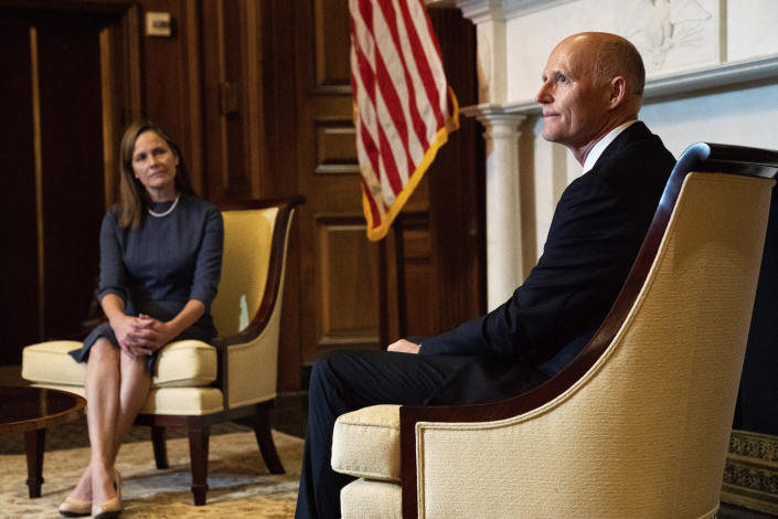 Sen. Rick Scott, R-Fla., right, meets with Judge Amy Coney Barrett, President Donald Trumps nominee for the U.S. Supreme Court, on Capitol Hill in Washington, Tuesday, Sept. 29, 2020. (Anna Moneymaker/The New York Times via AP, Pool)