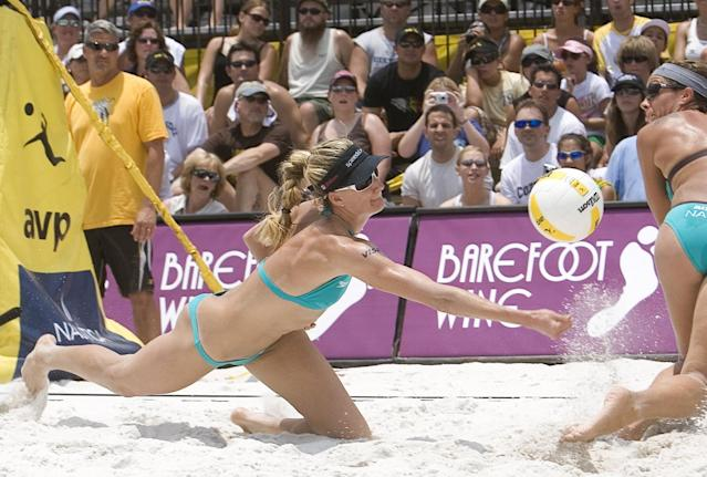 Kerri Walsh (L) digs the ball while partner Misty May-Treanor watches during the women's semifinals against Annett Davis and Jenny Johnson Jordan in the AVP esurance Tampa Open on June 3, 2007 in Tampa, Florida. Walsh/May-Treanor won the match against Davis/Johnson Jordan in three games, 21-18, 25-27, 15-9.