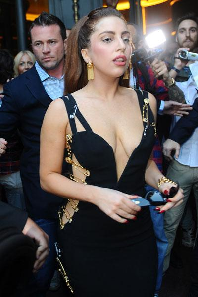 "Despite <a href=""http://ca.omg.yahoo.com/news/lady-gaga-thanks-fans-support-following-weight-gain-223710841.html"">getting criticism</a> for her recent weight gain, Lady Gaga looks the picture of health while out and about in Milan. The controversial singer stepped back in time in an iconic safety pin Versace dress that was first made famous by Elizabeth Hurley in 1994. INFphoto.com"