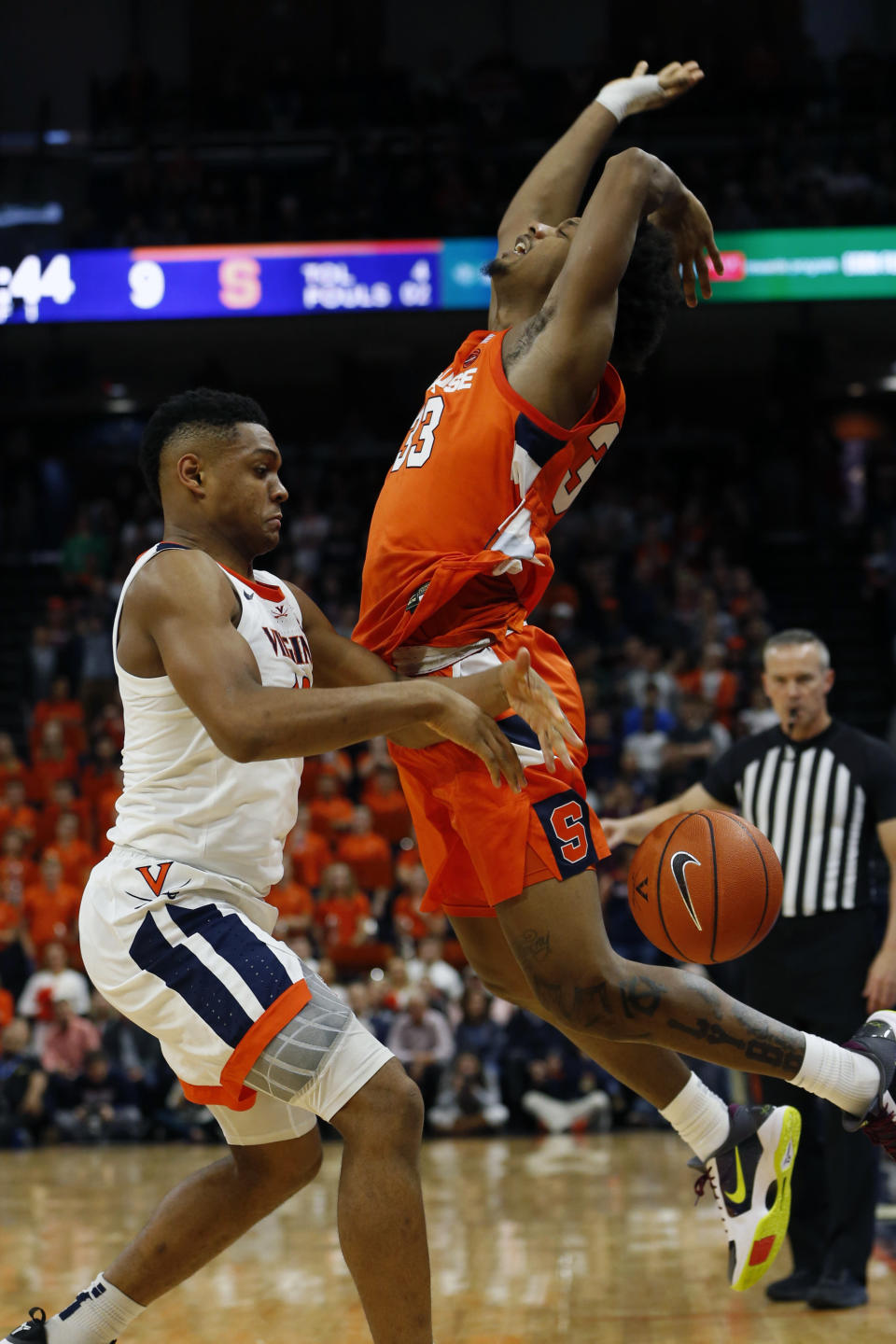 Syracuse forward Elijah Hughes (33) looses the ball as Virginia guard Casey Morsell (13) defends during the first half of an NCAA college basketball game in Charlottesville, Va., Saturday, Jan. 11, 2020. Morsell ws called for a four on the play. (AP Photo/Steve Helber)