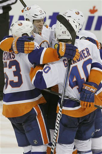 New York Islanders' Casey Cizikas (53), Matt Martin (17), Josh Bailey (12) and Michael Grabner (40) celebrate a shootout win over the Winnipeg Jets in an NHL hockey game in Winnipeg, Manitoba, Saturday, April 20, 2013. (AP Photo/The Canadian Press, John Woods)