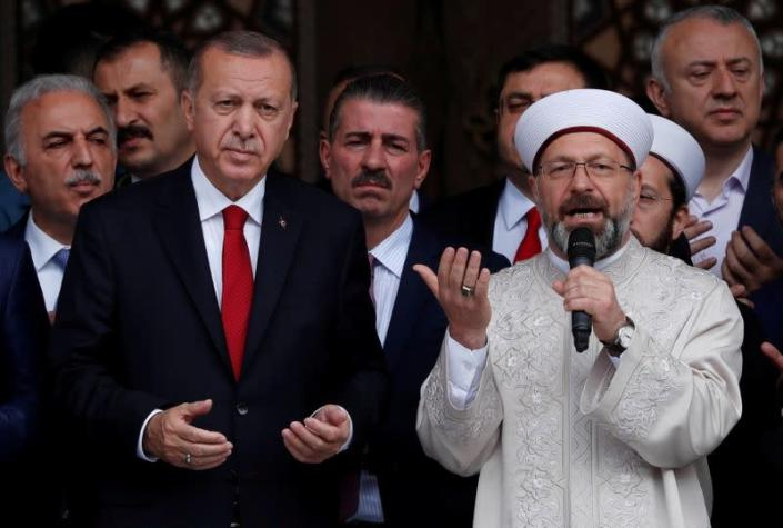 FILE PHOTO: Turkish President Erdogan prays during the opening ceremony of a mosque in Istanbul