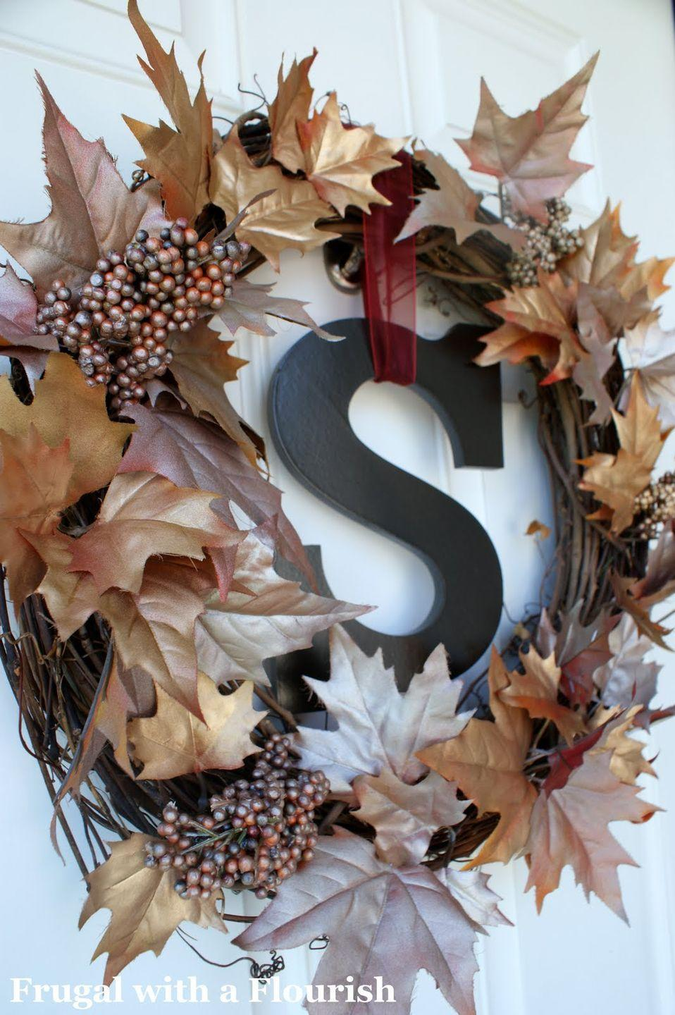 """<p>Metallic spray-paint turned bland faux leaves into a sparkling arrangement. </p><p><strong>Get the tutorial at <a href=""""http://frugalflourish.blogspot.com/2010/09/fall-wreath-with-bling.html"""" rel=""""nofollow noopener"""" target=""""_blank"""" data-ylk=""""slk:Frugal With a Flourish"""" class=""""link rapid-noclick-resp"""">Frugal With a Flourish</a>.</strong></p>"""