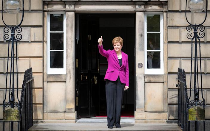 Scottish First Minister Nicola Sturgeon on the steps outside Bute House in Edinburgh after the SNP won a fourth victory in the Scottish Parliament election - Jane Barlow/PA