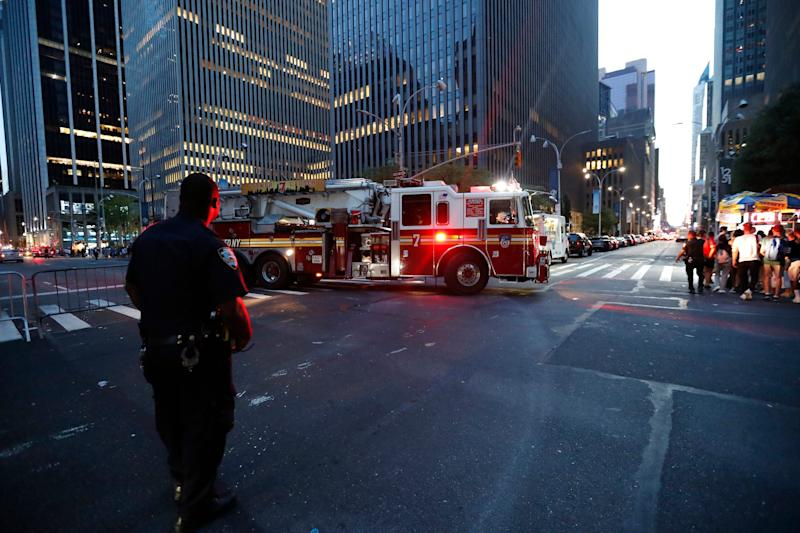 Fire trucks respond during a widespread power outage in the Manhattan borough of New York, Saturday, July 13, 2019.