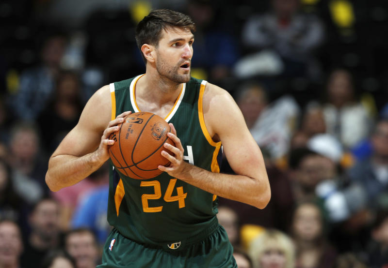 FILE - In this Nov. 20, 2016, file photo, Utah Jazz center Jeff Withey looks to pass in the first half of an NBA basketball game against the Denver Nuggets in Denver. Manhattan Beach, Calif., police spokesman Sgt. Tim Zins said Thursday, April 20, 2017, that a police report had been filed accusing Withey of domestic violence and detectives are looking into it.   The Jazz said in a statement that the team is aware of the allegations against Withey but would not comment until they had a better understanding of the situation. (AP Photo/David Zalubowski, File)