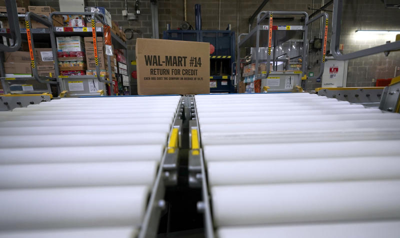 FILE- In this Nov. 9, 2018, file photo a box of merchandise is unloaded from a truck and sent along a conveyor belt at a Walmart Supercenter in Houston. Retailers like Walmart, Target and Best Buy that have been responding faster to a more competitive landscape with expanded delivery services and spruced up stores are enjoying strong sales. (AP Photo/David J. Phillip, File)