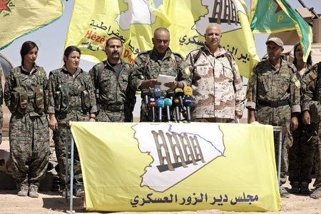Ahmed Abu Kholeh, head of the Deir al-Zor military council which fights under the Syrian Democratic Forces (SDF), speaks during a press conference in the village of Abu Fas, Hasaka province, Syria September 9, 2017. REUTERS/Rodi Said