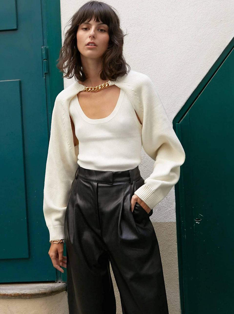 """Honestly, the cream version of this Pixie Market shrug is just as good the black—10/10 would add both to cart. $105, Pixie Market. <a href=""""https://www.pixiemarket.com/products/chain-link-knit-bolero?"""" rel=""""nofollow noopener"""" target=""""_blank"""" data-ylk=""""slk:Get it now!"""" class=""""link rapid-noclick-resp"""">Get it now!</a>"""
