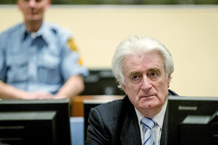 """Bosnian Serb wartime leader Radovan Karadzic, a former psychiatrist, has denounced his conviction as unjust and appealed on 50 grounds, accusing judges of conducting a """"political trial"""" (AFP Photo/Robin van Lonkhuijsen)"""