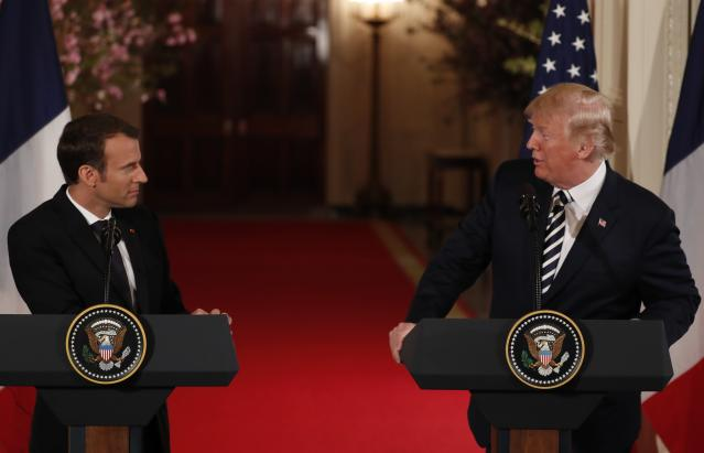 <p>French President Emmanuel Macron and U.S. President Donald Trump look over at each other during their joint news conference at the White House in Washington, April 24, 2018. (Photo: Jonathan Ernst/Reuters) </p>