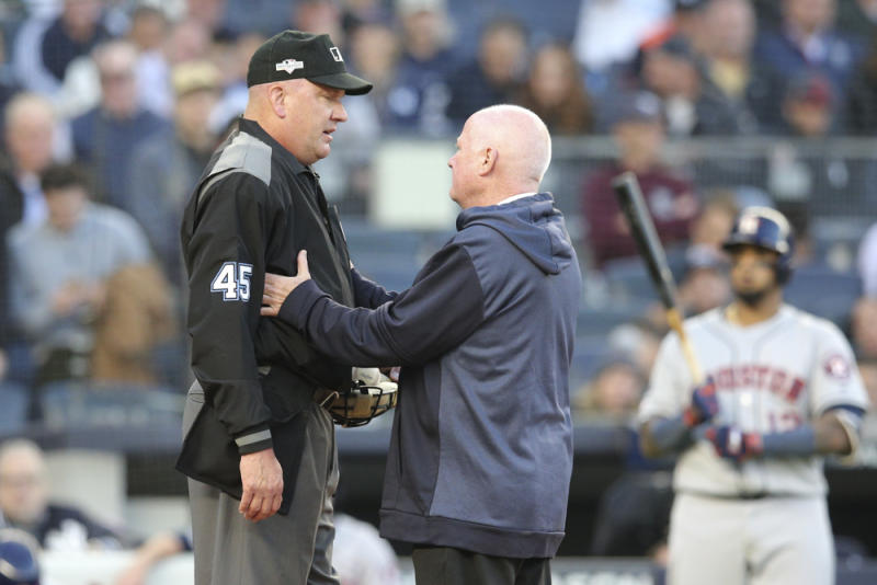 Oct 15, 2019; Bronx, NY, USA; MLB home plate umpire Jeff Nelson is checked by New York Yankees trainer Steve Dooahue after a foul ball during the fourth inning in game three of the 2019 ALCS playoff baseball series against the Houston Astros at Yankee Stadium. Mandatory Credit: Brad Penner-USA TODAY Sports