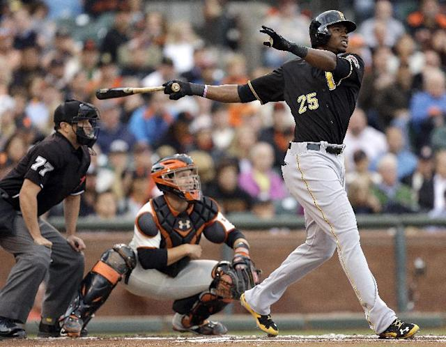 Pittsburgh Pirates' Gregory Polanco (25) swings for an RBI sacrifice fly off San Francisco Giants' Madison Bumgarner in the first inning of a baseball game Monday, July 28, 2014, in San Francisco. (AP Photo/Ben Margot)